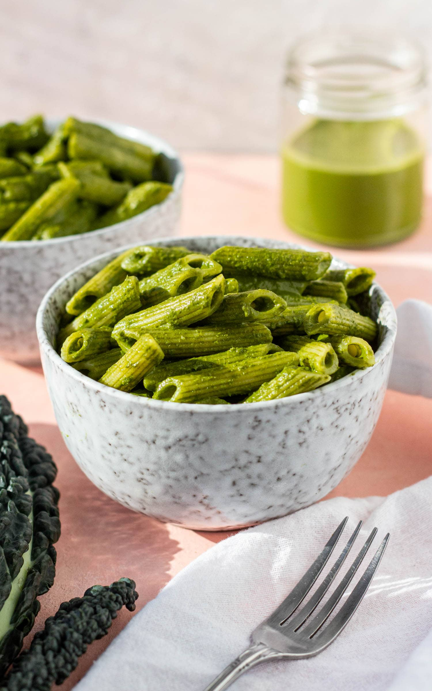 scene with bowls of kale pasta
