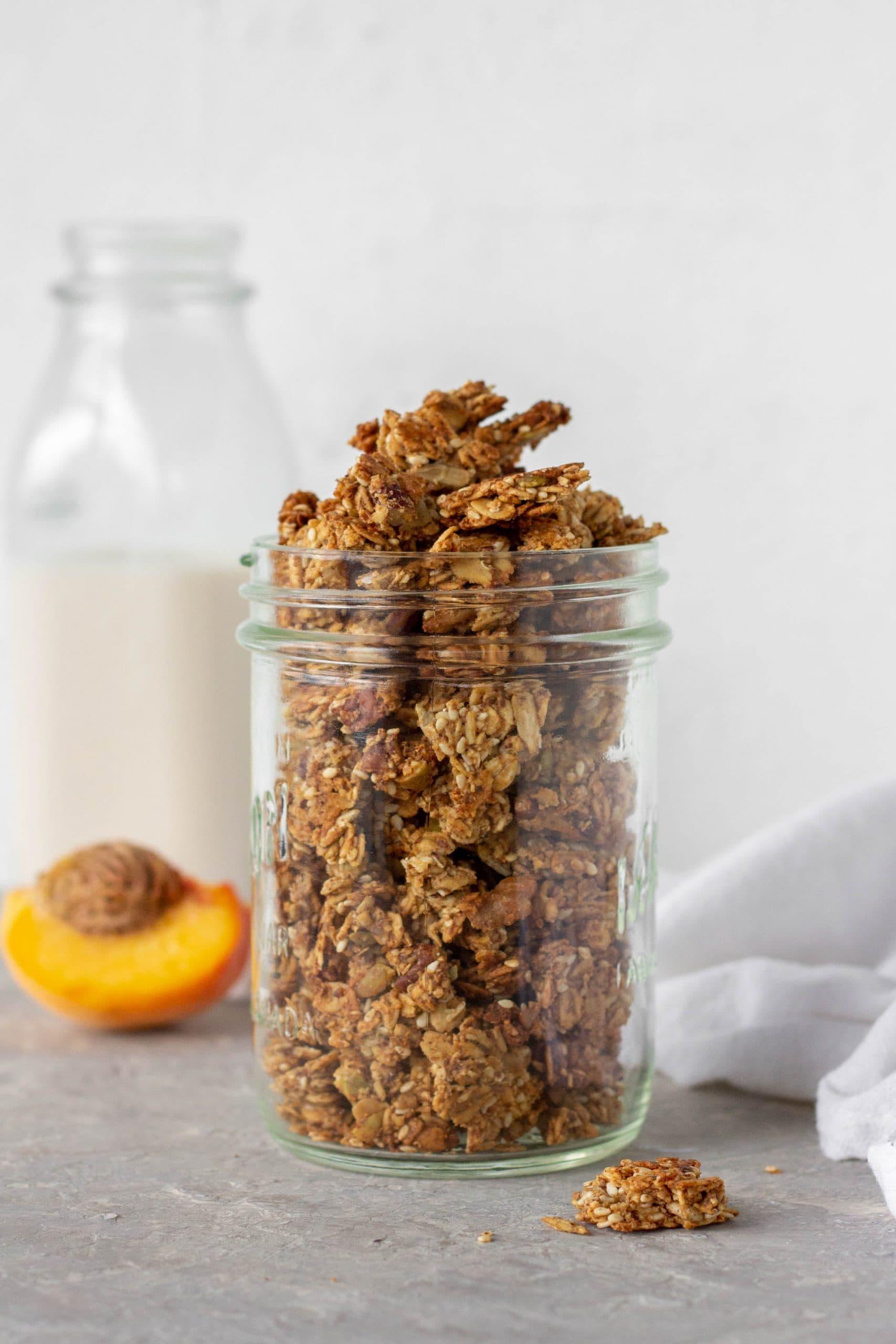 homemade almond butter granola in a glass jar